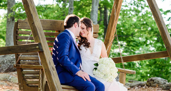 Bride & Groom Sitting on Wooden Bench