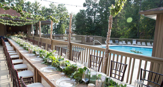 Group Dinner Table Setup by Pool