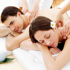 Man and Woman Getting Massages