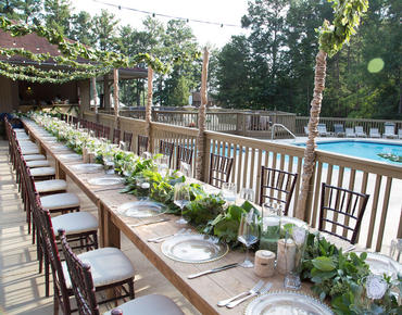 Group Dining Table Setup by Pool